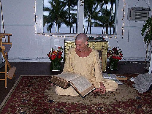 A visiting yogi reading the Ministry house Bible